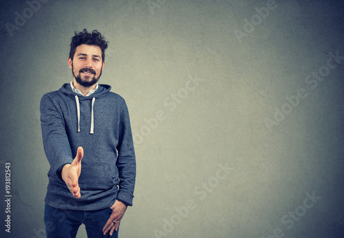 Young man greeting with handshake Wallpaper Mural