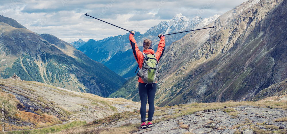 Fototapety, obrazy: Young woman hiking in the mountains
