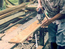 Carpenter Cutting Wooden Panel...