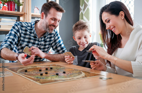 Fototapeta Happy family playing board game at home obraz