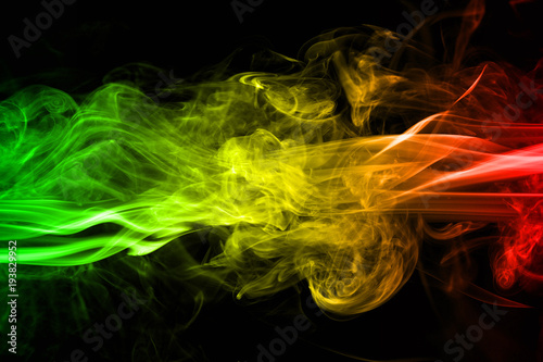 Fotografía abstract background smoke curves and wave reggae colors green, yellow, red color