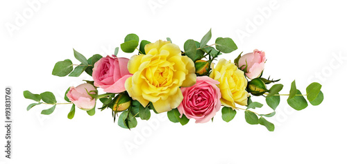 Pink and yellow rose flowers with eucalyptus leaves