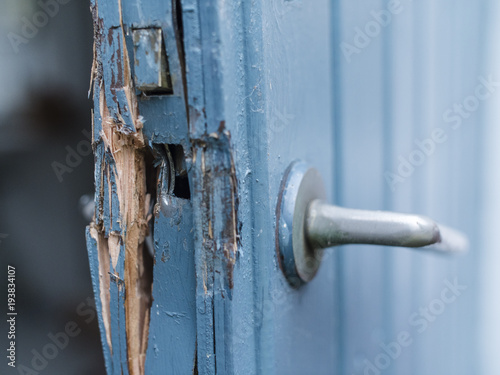 Broken door in blue and white colors after a burglery Canvas-taulu