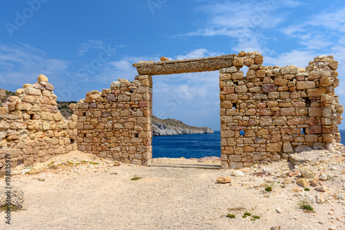 In de dag Rudnes The ruins of an ancient building in the picturesque village of Firopotamos on Milos Island. Cyclades, Greece.