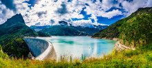 Panorama Of The Dam At Lake Emosson Near Chamonix (France) And Finhaut (Switzerland) During A Sunny Summer Day