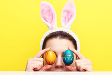 Happy Young Woman Wearing Bunny Ears And Having Easter Eggs