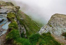Rocky Cliffs In Foggy Weather....