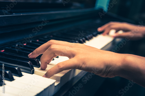 A pianist is playing piano. Canvas
