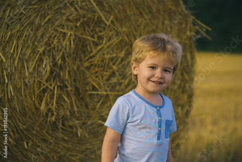 Child play on farm or ranch field, vacation Canvas Print