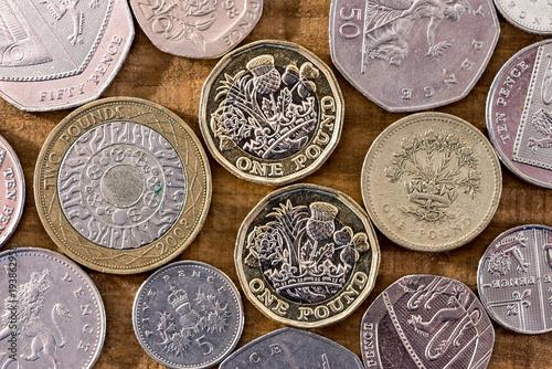 Obraz Pound - different british coin on table - fototapety do salonu