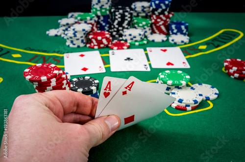 Foto  Woman looking gambling poker card in casino