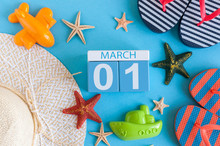 March 1st. Image Of March 1 Calendar With Summer Beach Accessories And Traveler Outfit On Background. Spring Like Summer Vacation Concept