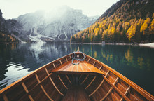 Wooden Rowing Boat On A Lake In The Dolomites In Fall