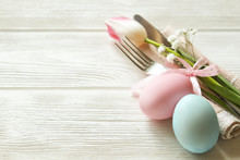 Easter Laying Table Appointments, Table Setting Options. Silverware, Tableware Items With Festive Decoration. Fork, Knife And Flowers. Happy Easter Holiday.