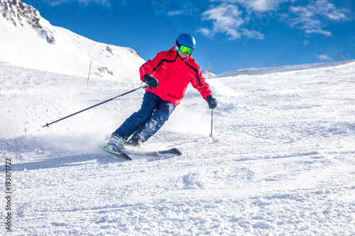 obraz lub plakat Man skiing on the prepared slope with fresh new powder snow in Tyrolian Alps, Zillertal, Austria