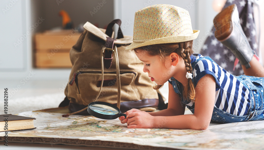 Fototapeta funny child girl tourist with world map, backpack and magnifier.