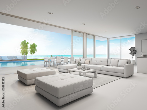 Outdoor dining and sea view living room of luxury beach ...