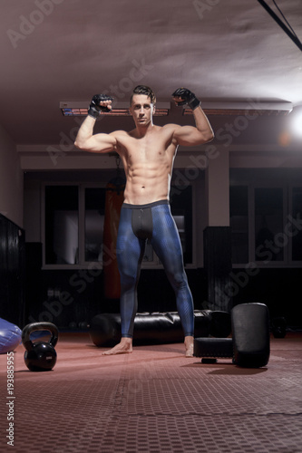 one boxer posing, indoors, fitness boxing equipment, flooring Tablou Canvas