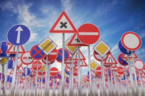 Cuadros en Lienzo Many road signs against blue sky. 3D rendered illustration.
