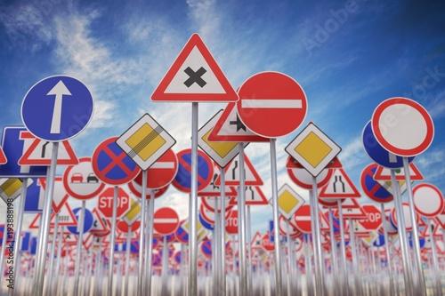 Many road signs against blue sky. 3D rendered illustration.