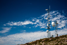 Mountain Top Weather Station With A Blue Sky