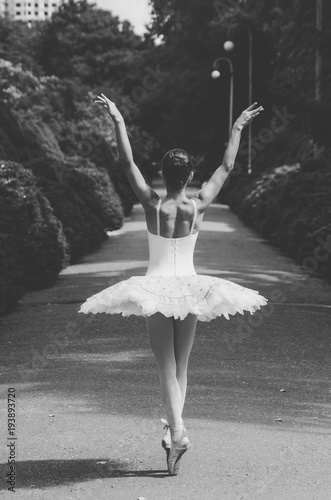 ballerina black and white posing in the park