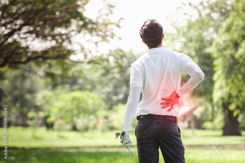 Asian sport young man accident ache back body injury play action goft, Muscle injury concept.