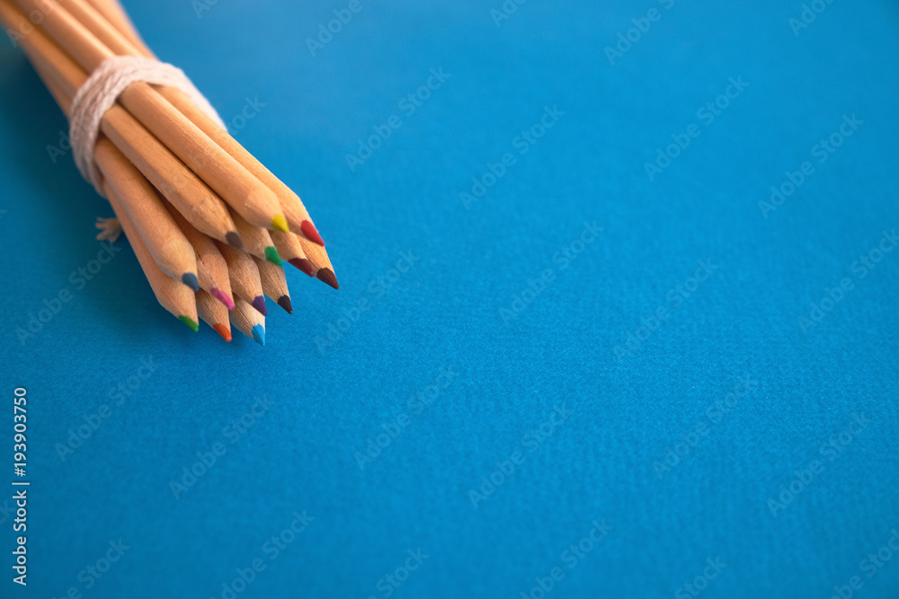 Fototapety, obrazy: Set of colored pencils against blue background