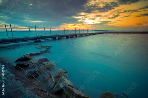 Valokuva  Pier on the lake Balaton at sunset.  Hungary