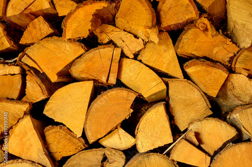 Poster Brandhout textuur Photo of chopped firewood texture in warm tone