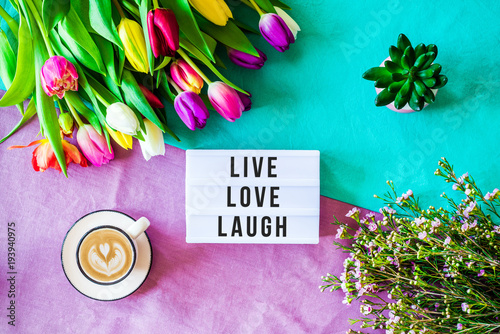 Live love laugh written in lightbox with spring flowers from above Poster