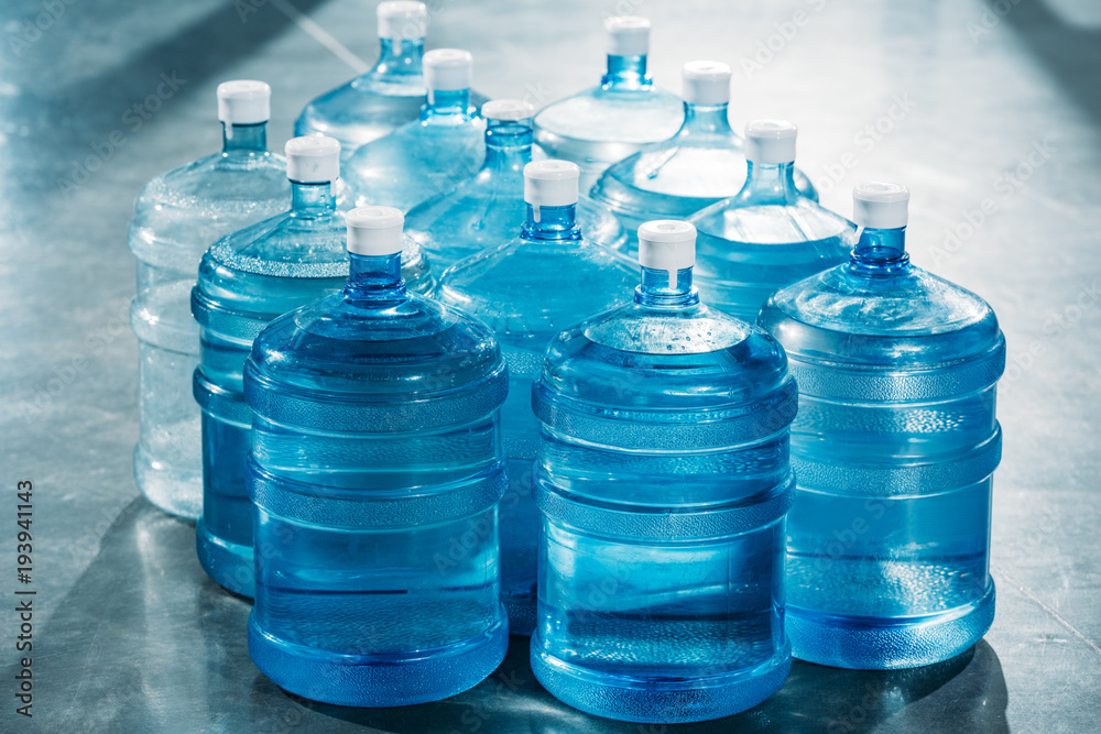 Obraz Delivery concept with large blue water bottles fototapeta, plakat