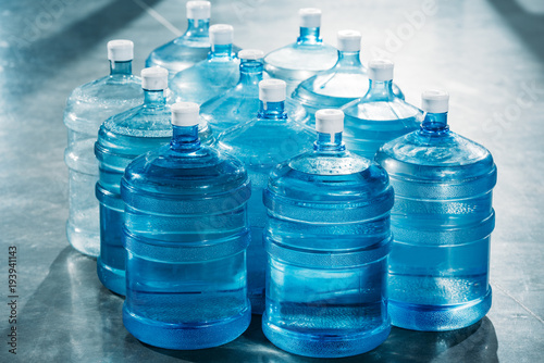 Fototapeta Delivery concept with large blue water bottles obraz