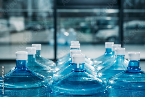 Fototapeta Rows of large blue water bottles obraz
