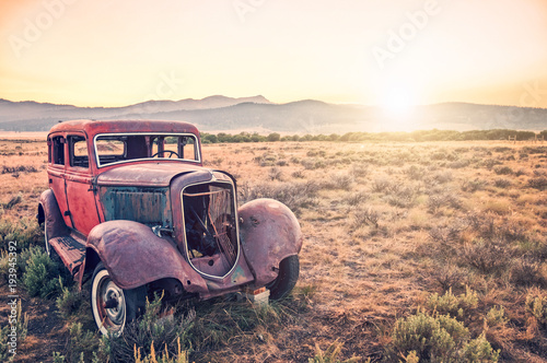 Recess Fitting Vintage cars Old rusty antique car, abandoned in a field at sunset