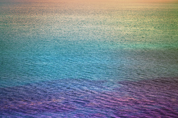 Background of ocean and texture sea water on sunset different color