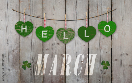 Valokuvatapetti Hello March written on hanging green hearts and weathered wooden background, wit