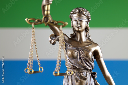 Fototapety, obrazy: Symbol of law and justice with Sierra Leone Flag. Close up.