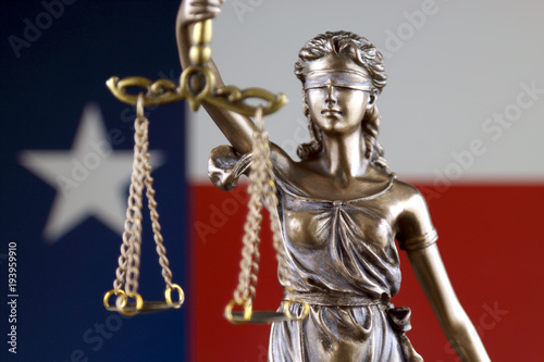 Photo Symbol of law and justice with Texas State Flag. Close up.