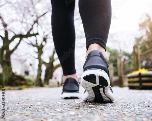 People Legs Sport shoe walk in Sakura Park outdoor Cherry blossom Japan Travel Wall mural
