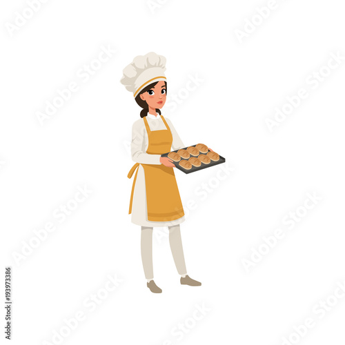 Obraz na plátně Young female baker character in uniform holding a tray with freshly baked bread