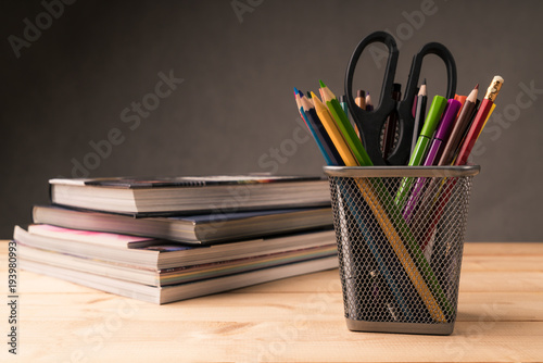 Fotografie, Obraz  color pencil in pen pot and book on working desk