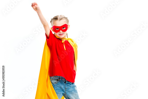 Supergirl wearing yellow cape and red mask for eyes gesturing by hand isolated o Wallpaper Mural