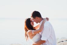 Wedding Couple Hugs On The Sea...