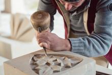 Stonemason Chiseling On Floral Stone Pattern