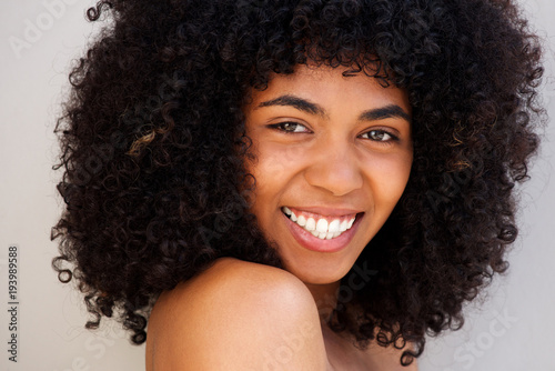 Fototapeta Close up cheerful young african american woman with curly hair obraz na płótnie