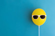 Yellow balloon with sunglasses