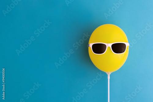 Fotografie, Obraz  Yellow balloon with sunglasses