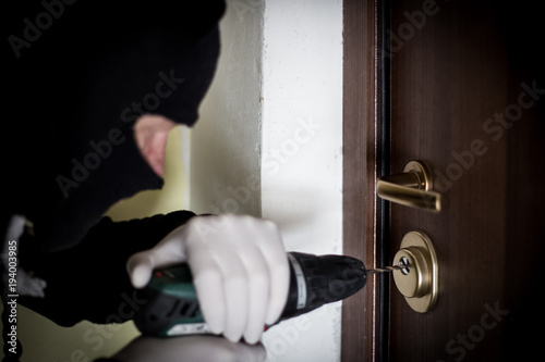 Crime Robbery Masked Thief Burglar Trying To Break Into A Flat Drill In The Hands