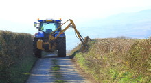 Tractor Mounted Hedge Cutter On A Country Road In East Devon